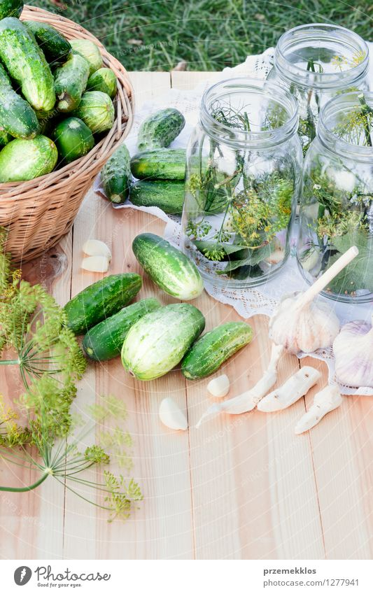 Preparing ingredients for pickling cucumbers Vegetable Herbs and spices Vegetarian diet Garden Fresh Natural Green Basket Canned Dill food Garlic glass healthy