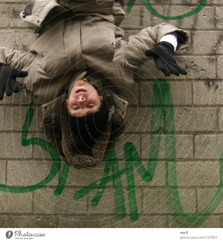 Human being Man Hand Youth (Young adults) Green Black Relaxation Wall (building) Wall (barrier) Graffiti Characters Climbing Derelict Jacket Cap Guy