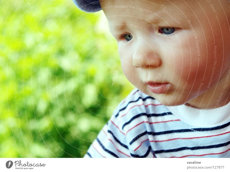 mini thinker Baby Child Skeptical Toddler Cap Striped Eyebrow Challenging Gnome Sweet Portrait photograph Facial expression Grief Looking Boy (child) Eyes Face