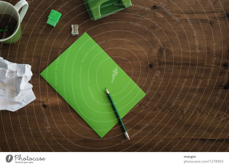 Green office: notepad with pencil, eraser, sharpener, hole punch and a cup of coffee Beverage Hot drink Coffee Cup Desk Table School Work and employment