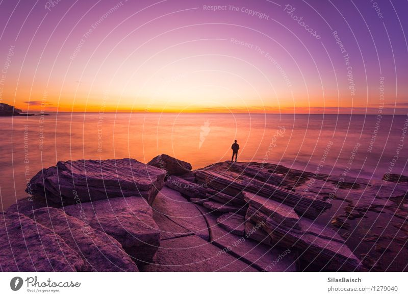 Sunrise over the ocean Human being Nature Vacation & Travel Man Summer Ocean Landscape Far-off places Beach Adults Coast Freedom Moody Rock Tourism