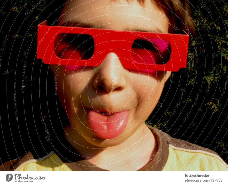 The picture of the picture in the picture Boy (child) Child Portrait photograph Eyeglasses Sunglasses Pink Red Happiness Joy Cool (slang) Brash Poster Grimace