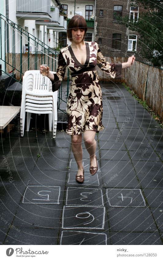Woman Beautiful Joy Jump Rain Glass Elegant Digits and numbers Alcoholic drinks Dress Asphalt Club Chalk Sparkling wine Hop