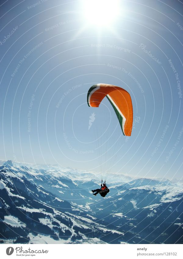 HeightsSunFlight Paraglider Paragliding Federal State of Tyrol Winter Hover Sunbeam Austria Sports Playing Mountain Alps Flying Blue Snow Freedom Vantage point