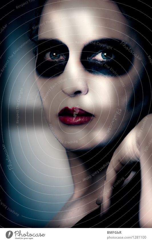 Made up woman looks out of window in shadow Make-up Hallowe'en Human being Woman Adults 1 Creepy Sadness Grief Death Guilty Shame Remorse Fear Dangerous