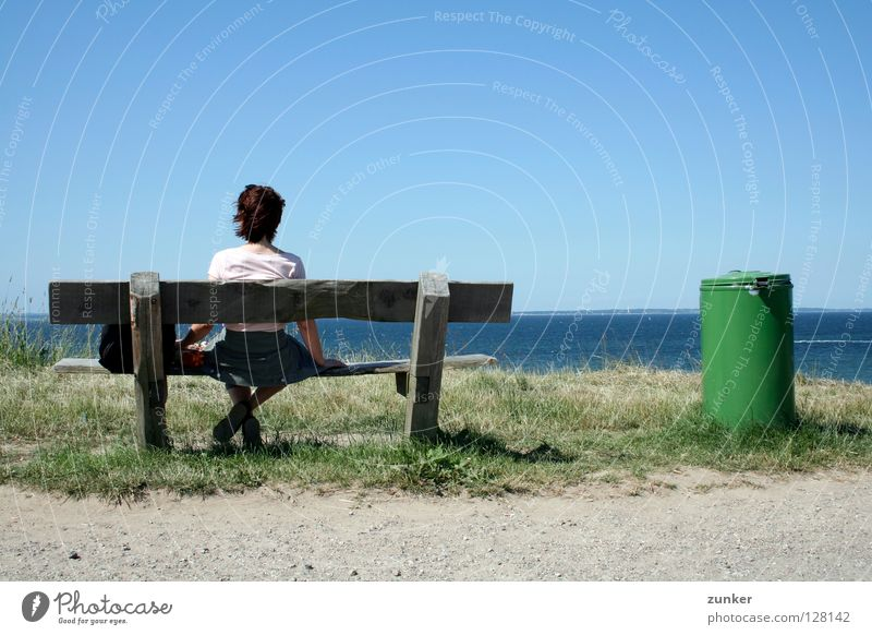 farsightedness Woman Wood Trash container Green Ocean Far-off places Grass Loneliness Break Exterior shot Concentrate Beach Coast Back Bench Water Sky