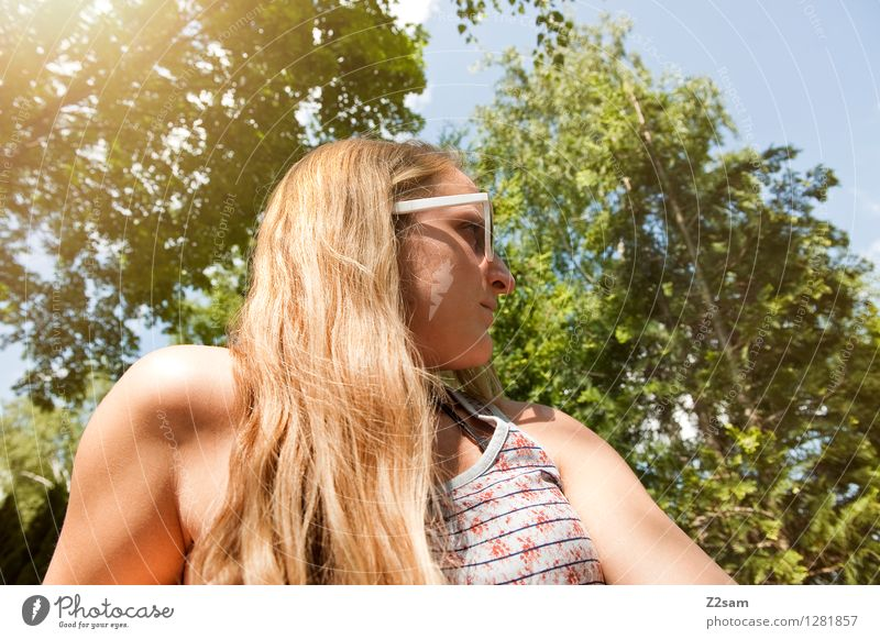 At the lake Lifestyle Style Environment Nature Summer Beautiful weather Tree Bushes T-shirt Sunglasses Blonde Long-haired Think Relaxation To enjoy Sit