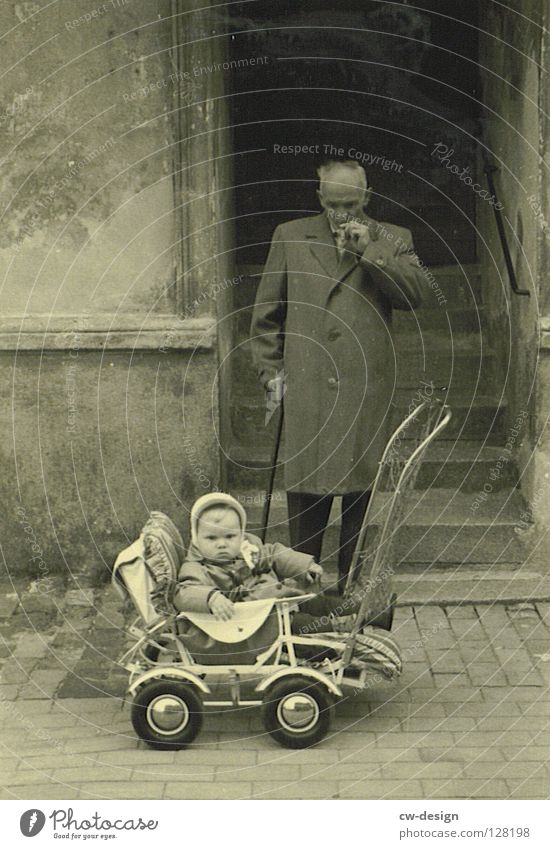 50ies - OPA PORSCHE Old Historic Black & white photo Child Childhood memory Male senior Exterior shot Grandfather Smoking Smoky Baby carriage Toddler Retro Coat
