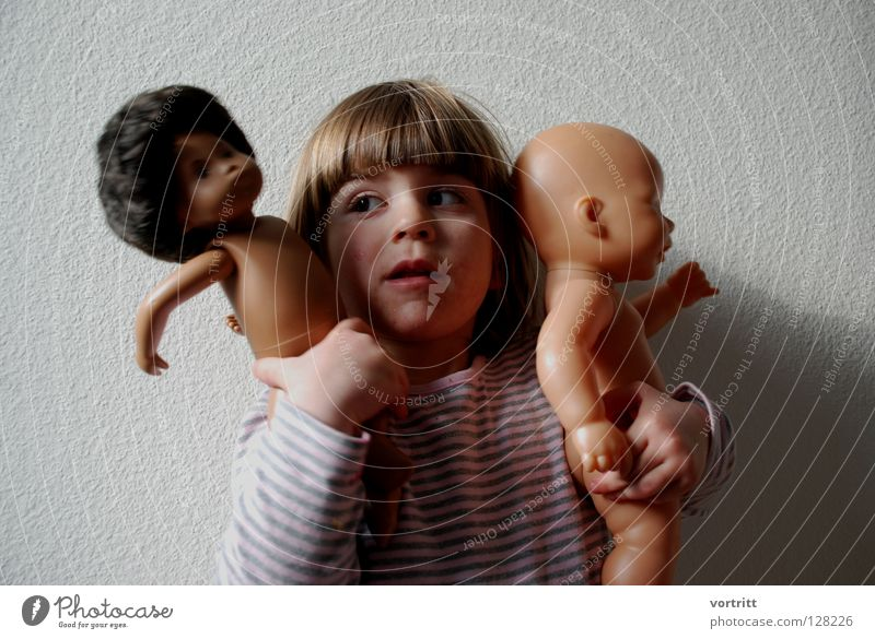 Child Girl Dark Wall (building) Playing Hair and hairstyles 2 Bright Shows To hold on Toddler Statue Indicate Attempt Striped Doll