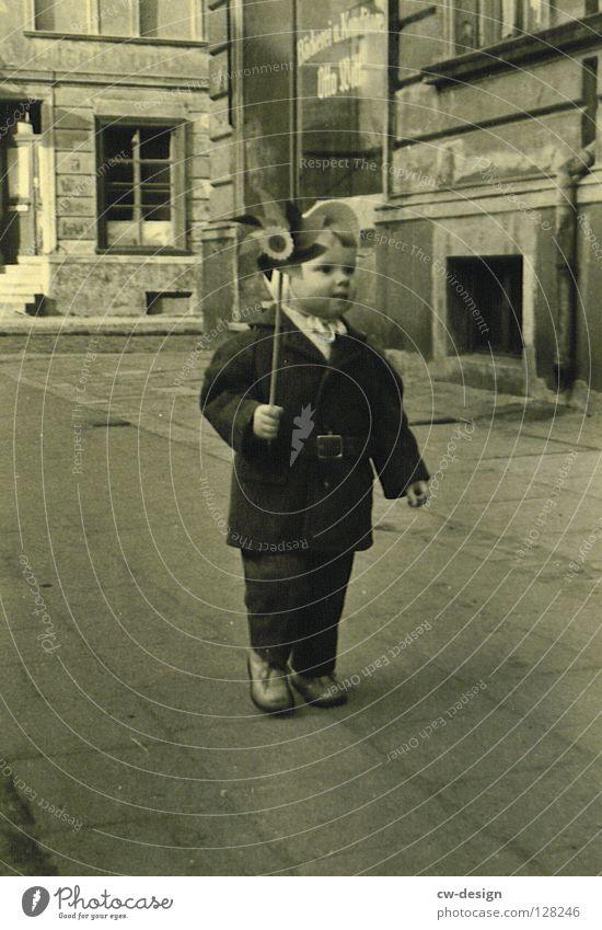 Human being Child Joy Happy Gray Free Infancy Sidewalk Traffic infrastructure Historic Coat Positive Childhood memory Pedestrian In transit Pinwheel