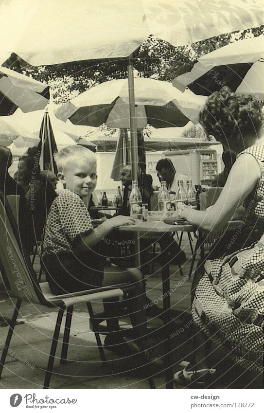 50ies - MAMA'S LIEBLING Sixties Historic Black & white photo Sidewalk café Beach café Looking into the camera Boy (child) 3 - 8 years Mother Young woman Summer