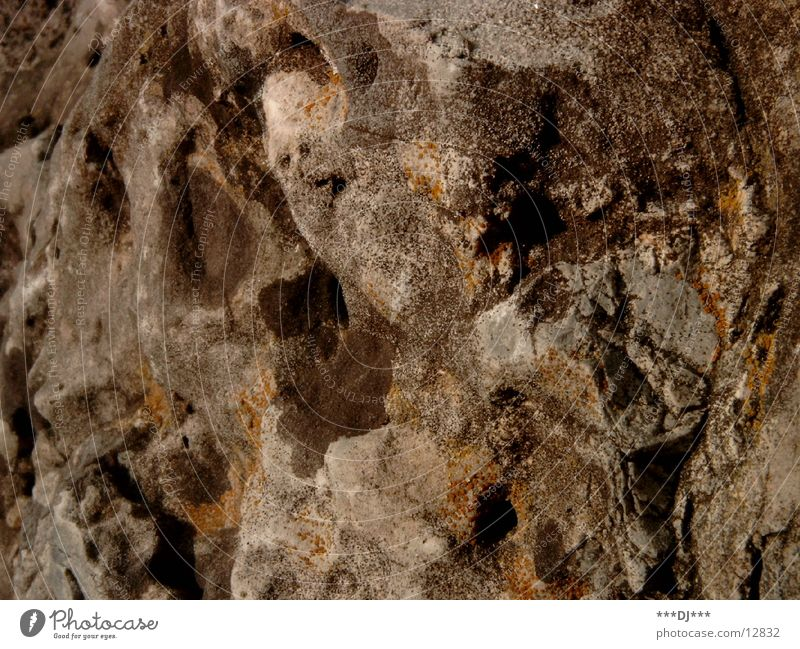 The stone Surface Stone Hard Sediment Nature Rock Uneven Surface structure Deserted Close-up Detail Hollow Multicoloured Sandstone Rough