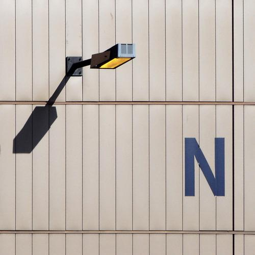 Shy N Inc. Lamp Wall (building) Tin Rectangle Corner Inexplicable Bracket Electricity Ventilation Day Craft (trade) Industry Safety Floodlight Shadow Warehouse