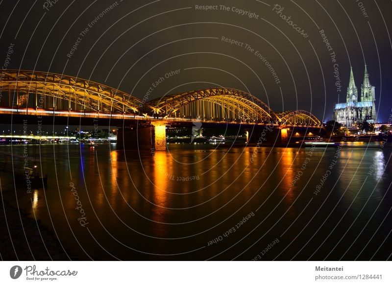 Hohenzollern Bridge Cologne Germany Europe Town Skyline Dome Tourist Attraction Landmark Train travel Rail transport Railroad Commuter trains Illuminate