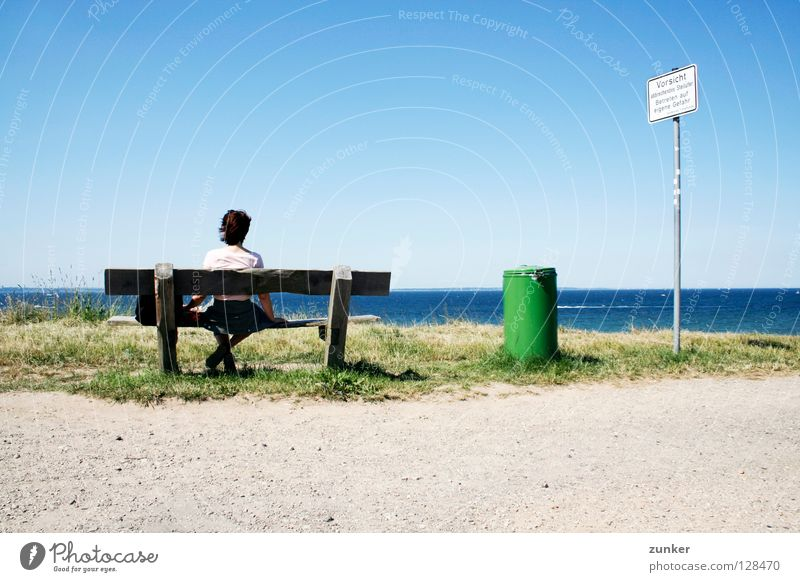 Watch it! Watch it! Woman Wood Trash container Green Ocean Far-off places Grass Loneliness Break Exterior shot Beach Coast Summer Back Bench Water Sky