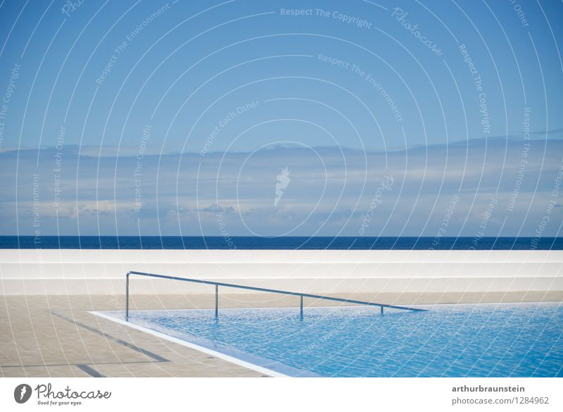 Swimming pool by the sea Lifestyle Luxury Athletic Calm Swimming & Bathing Leisure and hobbies Vacation & Travel Tourism Summer vacation Sunbathing Ocean