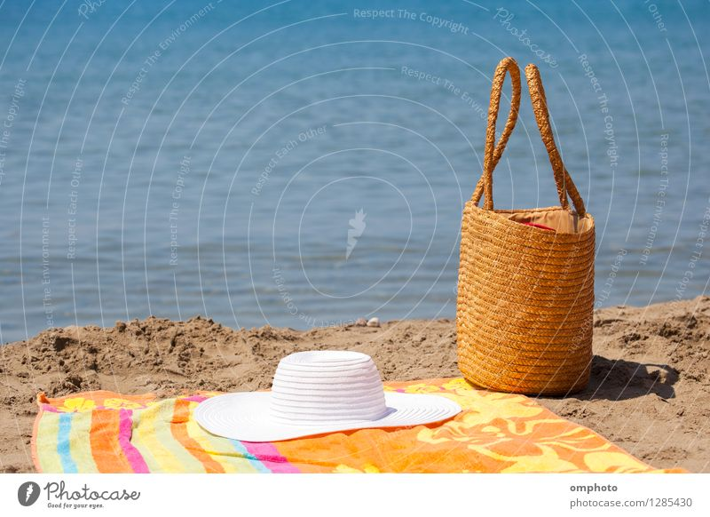 Hat Bag and Towel on the Beach Vacation & Travel Blue Summer White Sun Relaxation Ocean Warmth Feminine Coast Bright Sand Leisure and hobbies Tourism
