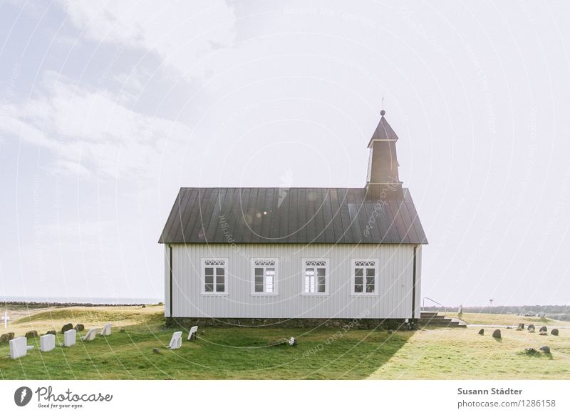 Loneliness Window Meadow Building Small Church Historic Village End Iceland Cemetery Church spire Clouds in the sky Halo