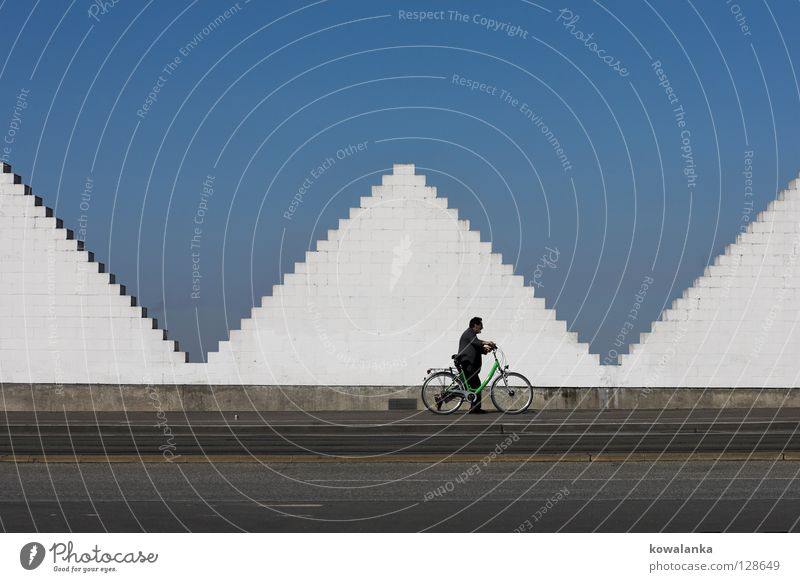Sky Man Blue White Loneliness Street Think Art Bicycle Going Walking Modern To go for a walk Beautiful weather Boredom Symmetry