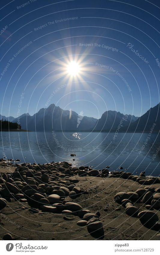 sunshine Autumn 2007 Sun over Bergen Lake and stones mogens Rocky´s USA