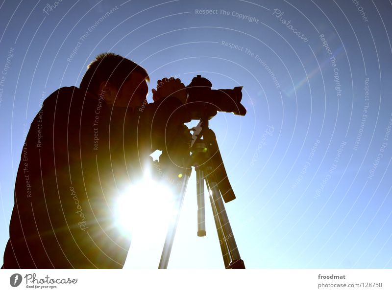 Man Sky Sun Winter Work and employment Lighting Photography Search Perspective Camera Concentrate Beautiful weather Photographer Take a photo Dazzle Lens
