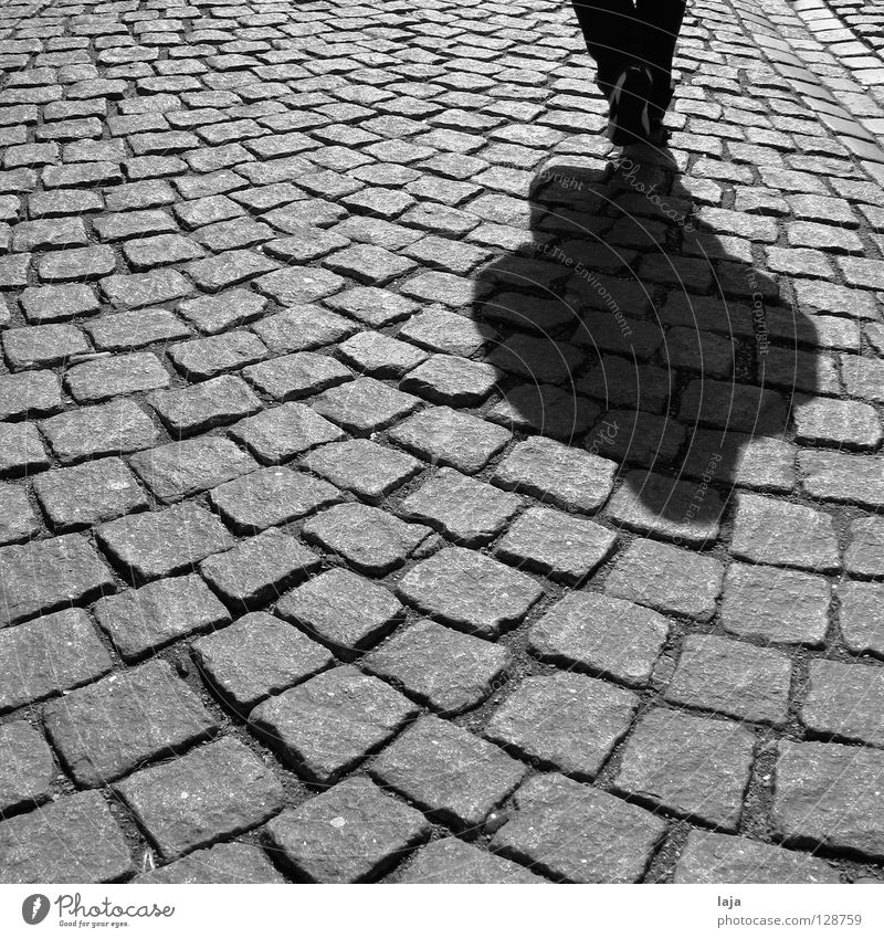 Hard plaster Cobblestones Human being Footwear Walking Shadow Stone Street Black & white photo Marburg To go for a walk Historic Traffic infrastructure contrast