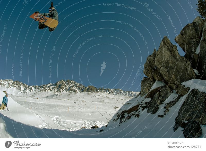 Winter Mountain Rock Jump Tall Touch Snowcapped peak Cloudless sky Brave Ski resort Snowscape Blue sky Snowboard Winter sports Freestyle Talented