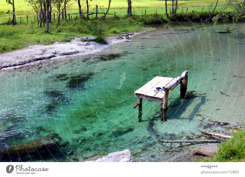 water lounger Lake Green Grass Wood Relaxation Vacation & Travel River Bench Water Mountain Stone Lie