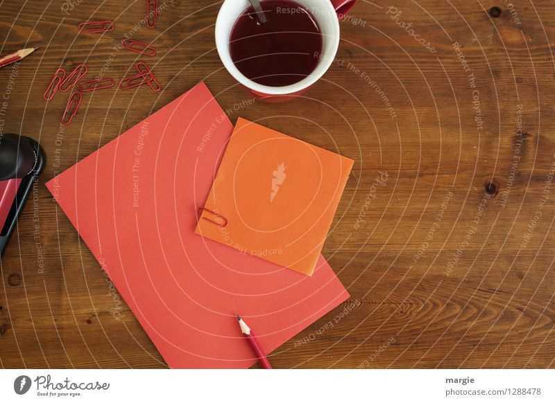 Red orange office: note with pencil, paper clips and a cup of red tea Hot drink Coffee Tea Cup Spoon Desk Table School Study Office work Business Stationery