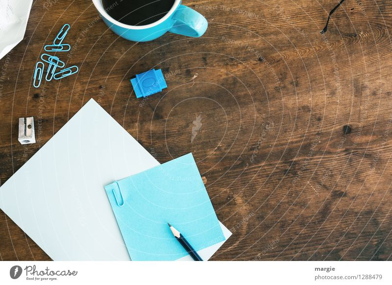 Blue office: note with pencil, sharpener, paper clips, eraser and a coffee cup Beverage Hot drink Coffee Cup Desk Table School Study Student