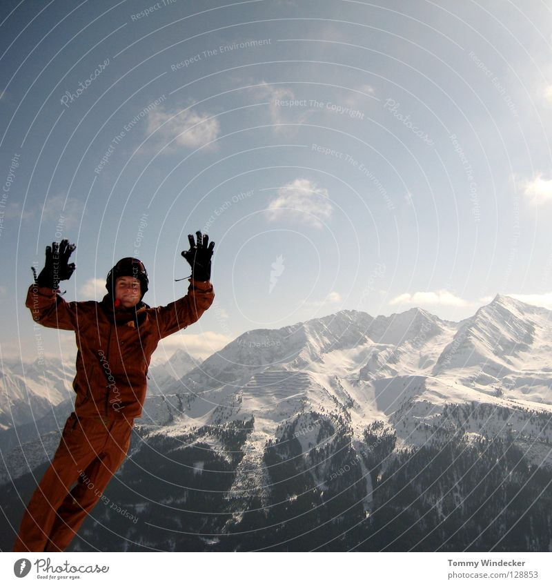 Human being Sky Nature Vacation & Travel Man Blue White Landscape Joy Winter Cold Mountain Snow Playing Laughter Jump