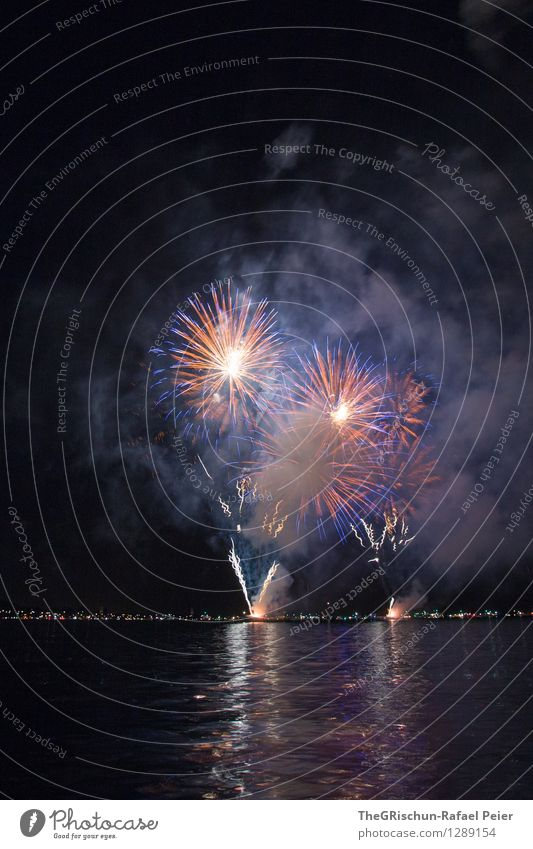 Fireworks 2 Work of art Stage play Blue Gold Orange Black Moody Joy Enthusiasm Euphoria Firecracker Spectacle Reflection Lakeside Feasts & Celebrations Firm