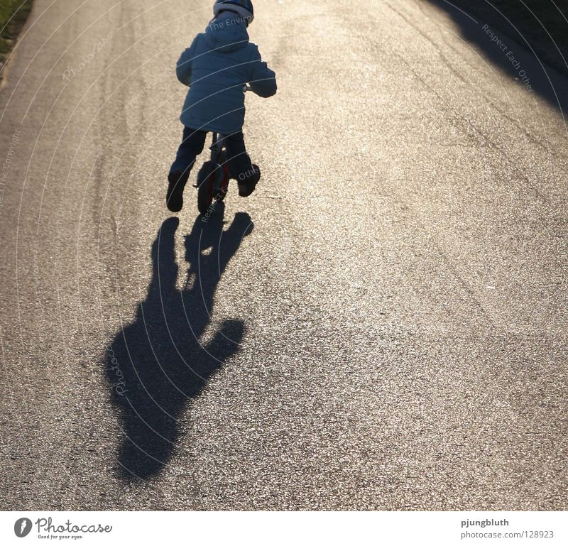 from home Child Light Asphalt February Back-light Contentment Practice Playing Sunday Toddler To go for a walk Shadow Street Study Kiddy bike