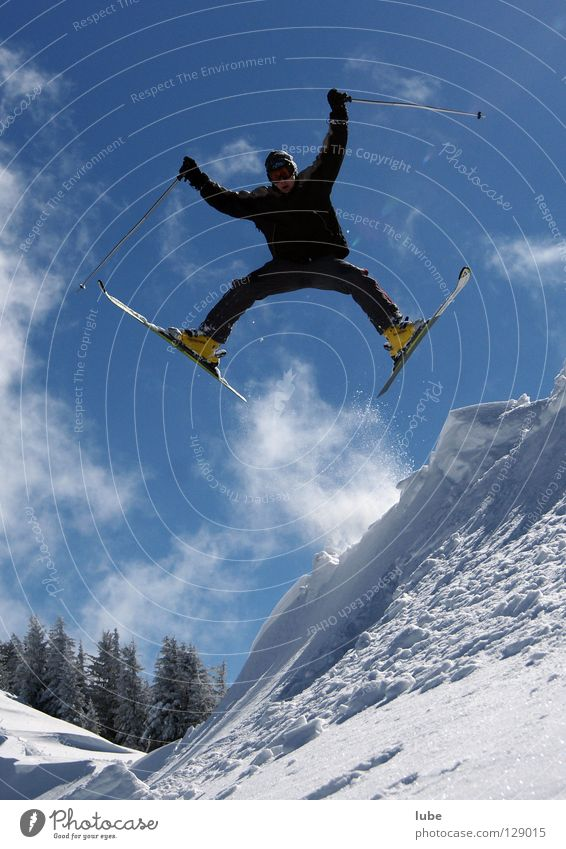 straddle Jump Straddle Skier Winter Deep snow Powder snow Winter sports Skiing freerider freeriding Snow