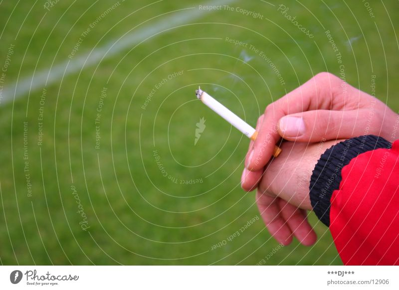 Hand Cold Playing Grass Line Search Fingers Lawn Leisure and hobbies Smoking Cigarette Football pitch