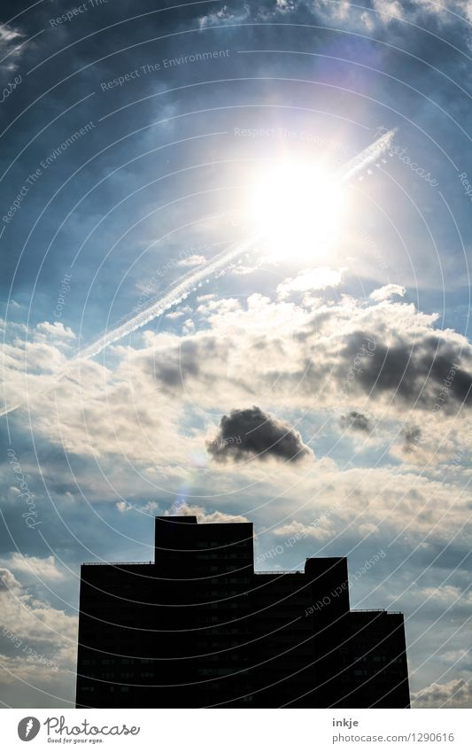 obscured Sky Clouds Sun Sunlight Beautiful weather Skyline Deserted House (Residential Structure) High-rise Building Facade Illuminate Threat Sharp-edged Large