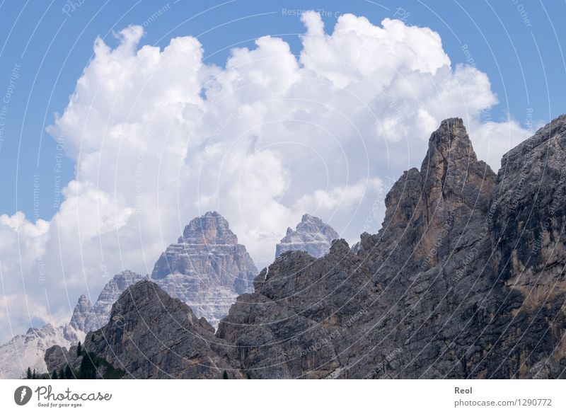 Clouds and rocks Environment Nature Landscape Elements Sky Summer Beautiful weather Rock Alps Mountain Dolomites South Tyrol Three peaks Peak Steep face Stone