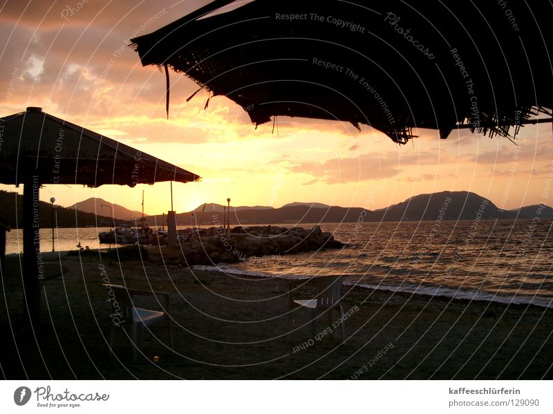 Sky Sun Ocean Beach Vacation & Travel Relaxation Sand Coast Island Sunshade Dusk Surf Evening sun Corfu