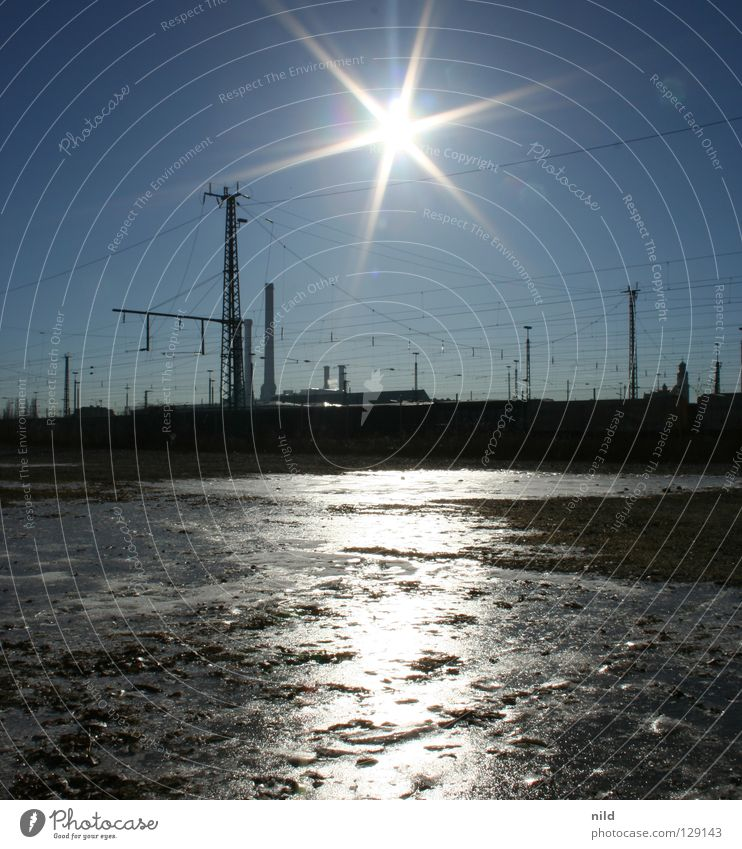 sun over sendling (unvershopped) Railroad tracks Town Back-light Cold Ice Frozen surface Overhead line Mirror Light South railroad station Sunbeam Winter Freeze
