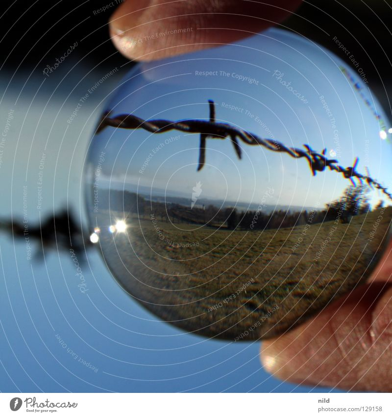 Lens in front of the lens 2 Reflection Rotated Foreground Background picture Point of light Round Blur Vaulting Beautiful Convex Focal point Barbed wire Meadow