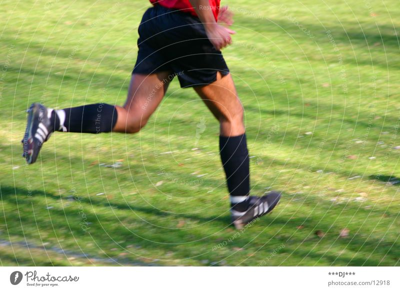 Run if you can! Man Football boots Shorts Abbreviate Grass Lose Playing Sports Human being Legs Feet Walking Soccer Beautiful weather