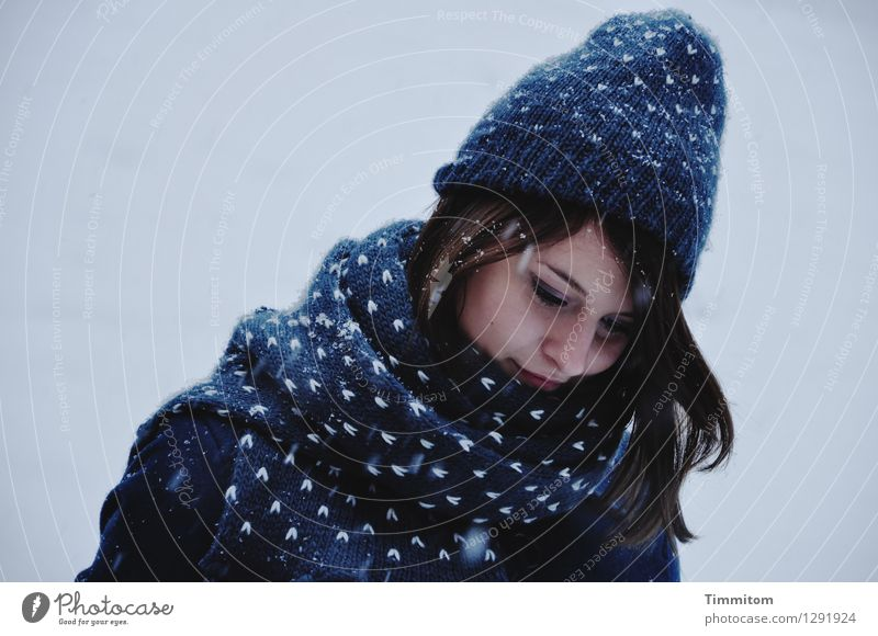In thought. Human being Young woman Youth (Young adults) Head 1 Winter Snow Snowfall Clothing Scarf Cap Hair and hairstyles Blue Gray White Emotions Contentment