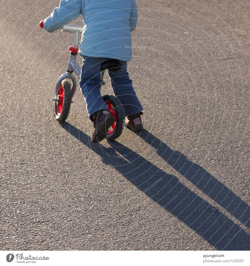 Child Street Playing Contentment Study To go for a walk Asphalt Practice February Bicycle Kiddy bike