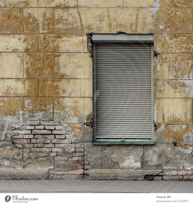 Do you still live? House (Residential Structure) Wall (building) Wall (barrier) Window Roller shutter Yellow Broken Decompose Brick Archaic Building Beige