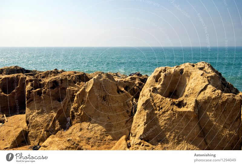 Sky Nature Blue Summer Water Ocean Landscape Far-off places Environment Coast Stone Brown Rock Horizon Weather Waves