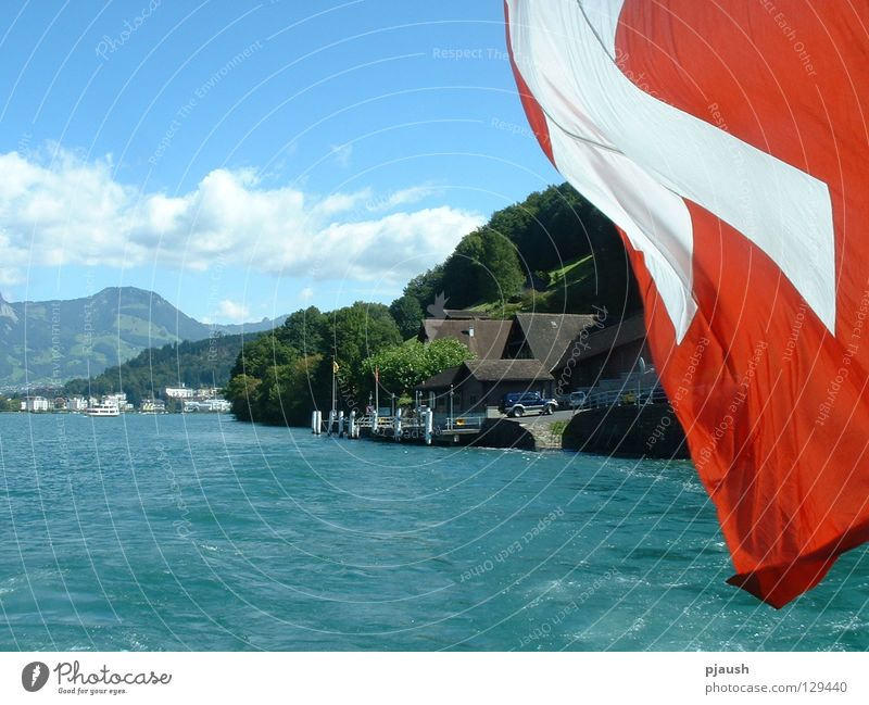 Steamer trip on Lake Lucerne Switzerland Flag House (Residential Structure) Water Mountain