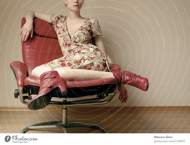 Sit-in. Posture Woman Armchair Leather Footwear Flower Dress Clothing Boots Red Multicoloured Furniture Slouch Crouch Thigh Lower leg Get stuck Tights Nylon