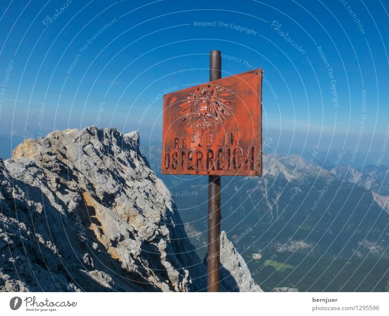 Tu felix Austria Sports Hiking Nature Sky Cloudless sky Summer Beautiful weather Alps Mountain Zugspitze Peak Stone Metal Signs and labeling Signage
