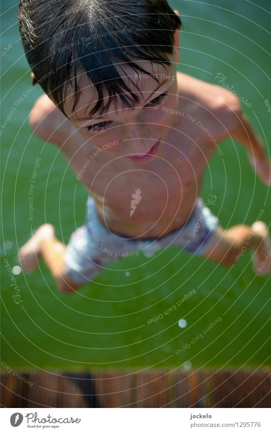 Jump and go Masculine Child Head 1 Human being 8 - 13 years Infancy Nature Water Swimming & Bathing Smart Speed Brown Green Colour photo Exterior shot Day Light
