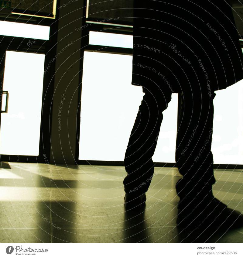 Human being Man White Black Dark Window Gray Building Legs Bright Footwear Wait Door Floor covering Pants Tile